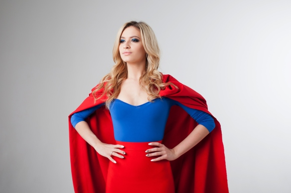 Superhero Woman. Young and beautiful blonde in image of superheroine